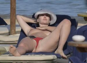 Bleona-Qereti-%E2%80%93-Topless-Pussy-Slip-in-Sardinia-%28NSFW%29-570f2vf5tk.jpg